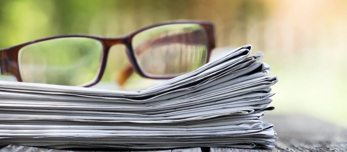 Morning news concept - newspaper and glasses with copy space