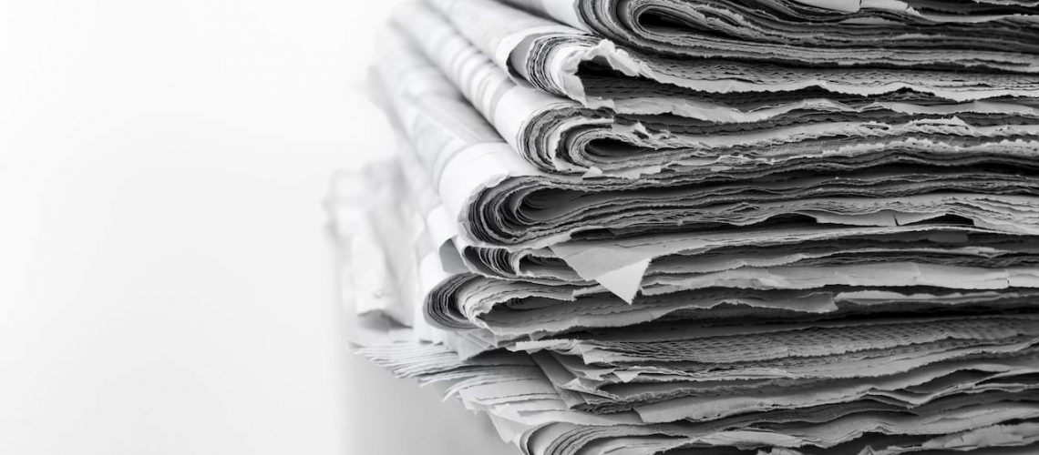 Newspapers folded and stacked concept for global communications and the media